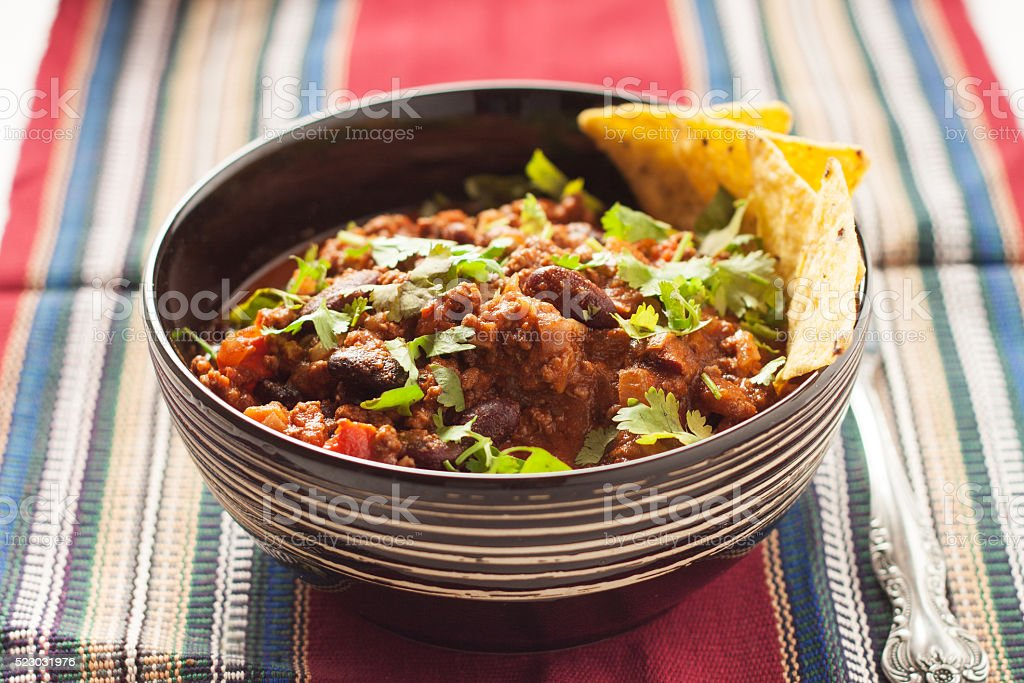 Chili con carne with tortilla chips stock photo
