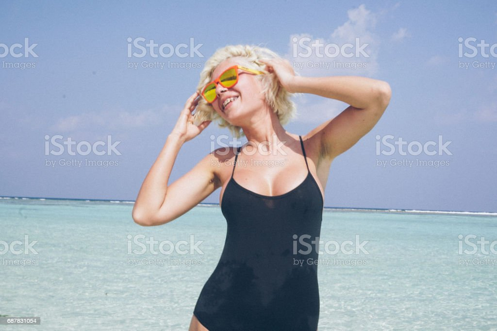 Chill out in shallow water on Maldives stock photo