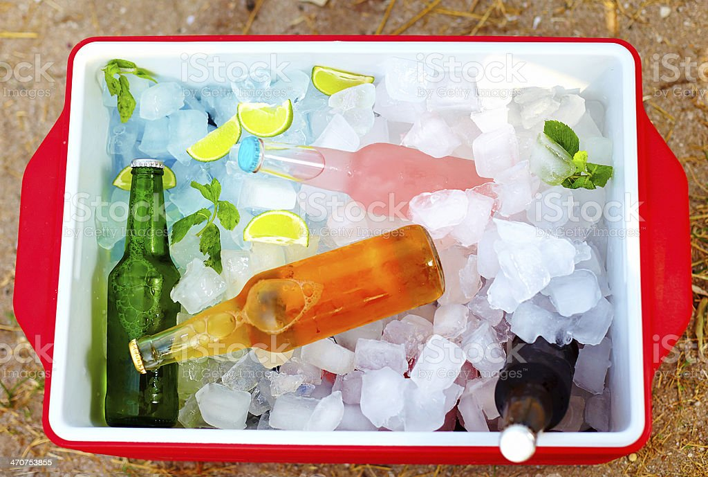 chilled colorful beverages in ice box. summer party stock photo