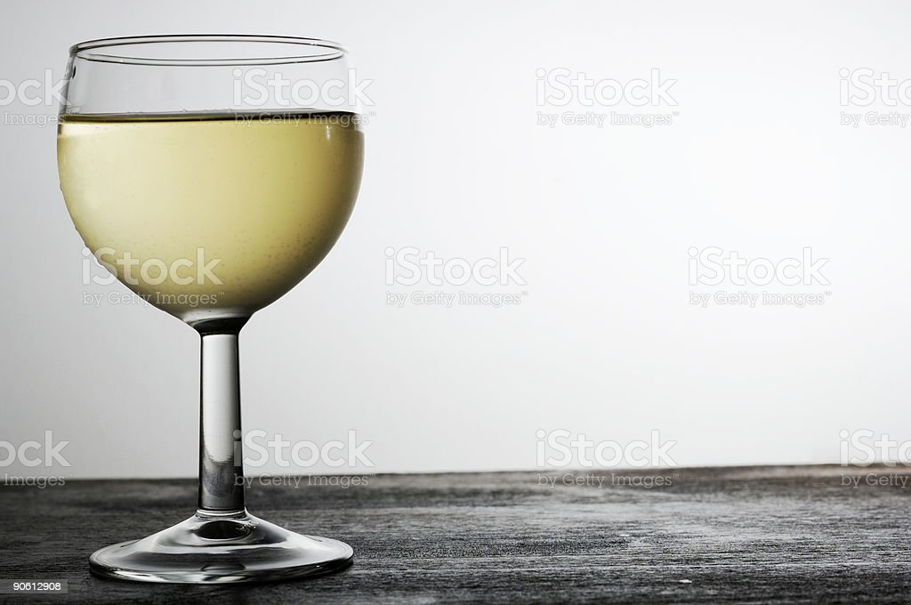 Chilled glass of white wine, backlit, room for copy royalty-free stock photo