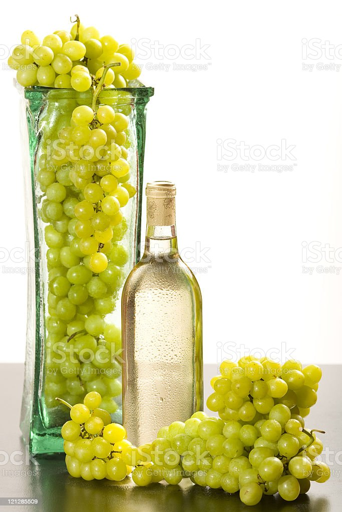 Chilled White Wine W/ Vase Full Of Grapes stock photo