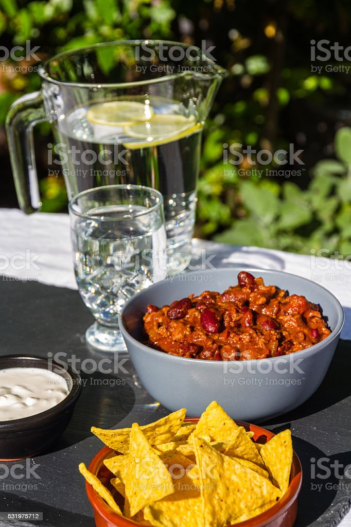 Chilli Con Carne in ceramic bowl with tortilla chips stock photo
