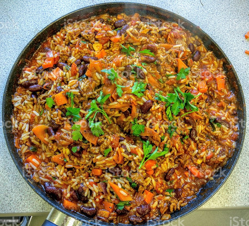 Chilli Con Carne with Rice in Frying Pan stock photo