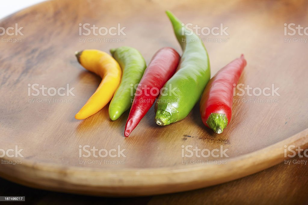 Chilli hot peppers in wooden tray royalty-free stock photo