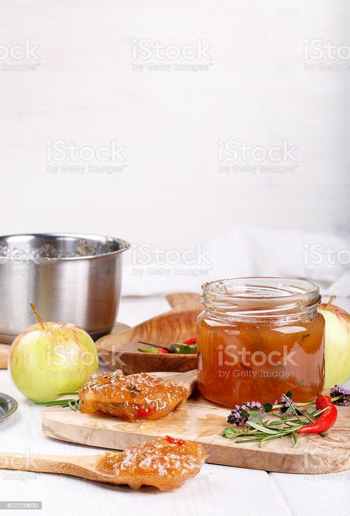 Chilli pepper apple jam with herbs stock photo