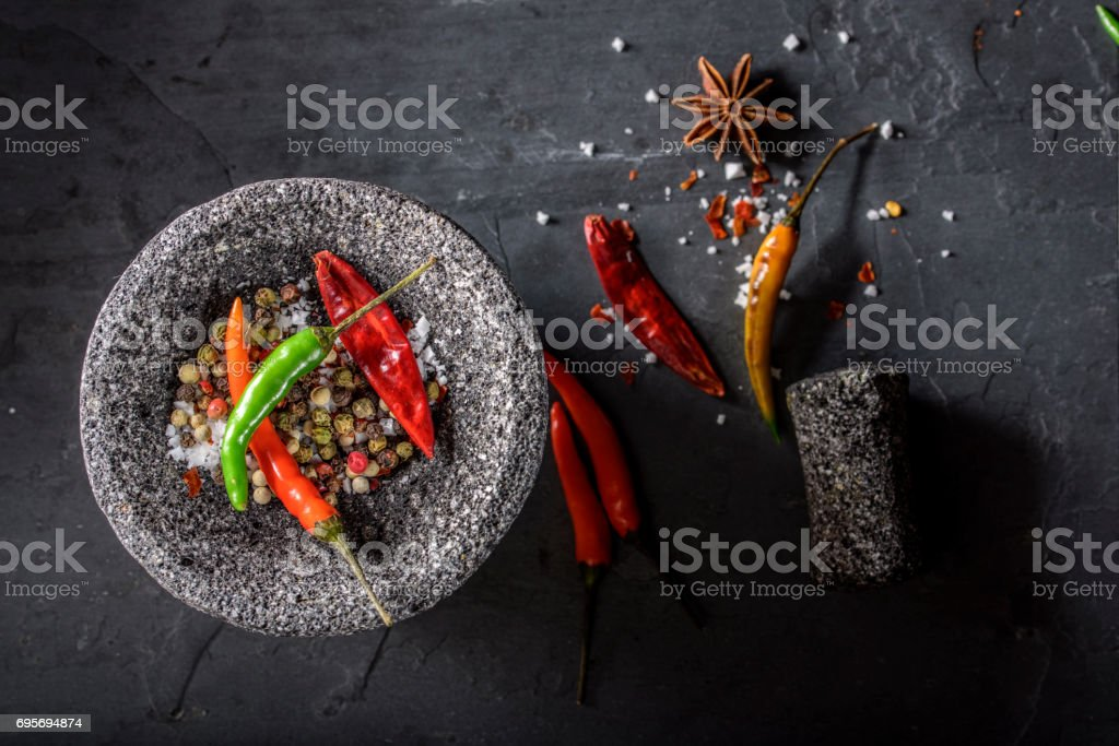 Chilli, Red Pepper Flakes and Sea Salt, Pepper, Mortar and Pestle stock photo