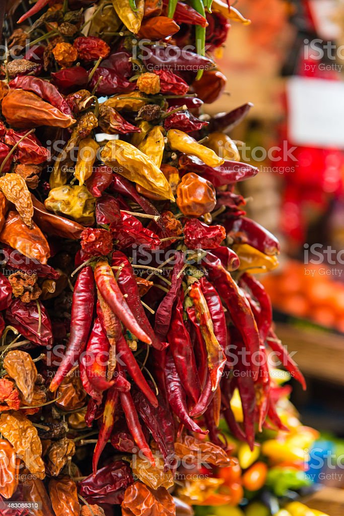 chillies or red pepper hanging at a market stock photo