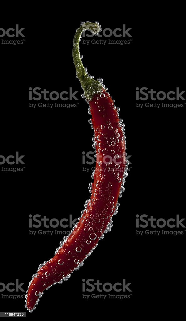 chillies pepper with water bubbles isolated on black  background royalty-free stock photo