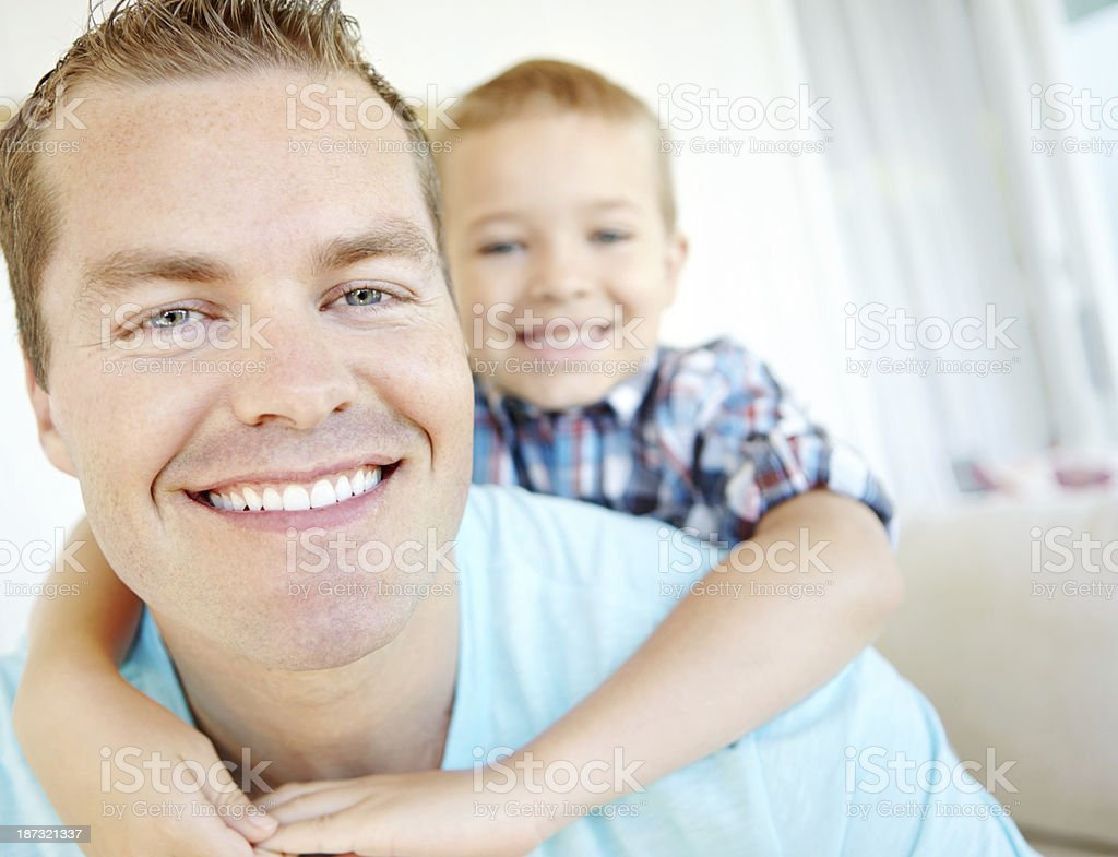 Chilling on the couch with dad royalty-free stock photo