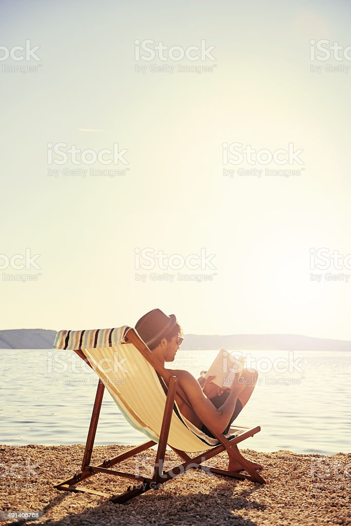 Chilling out with a good book stock photo
