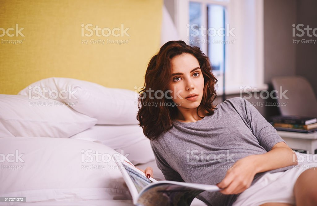 Chilling with her favourite magazine stock photo