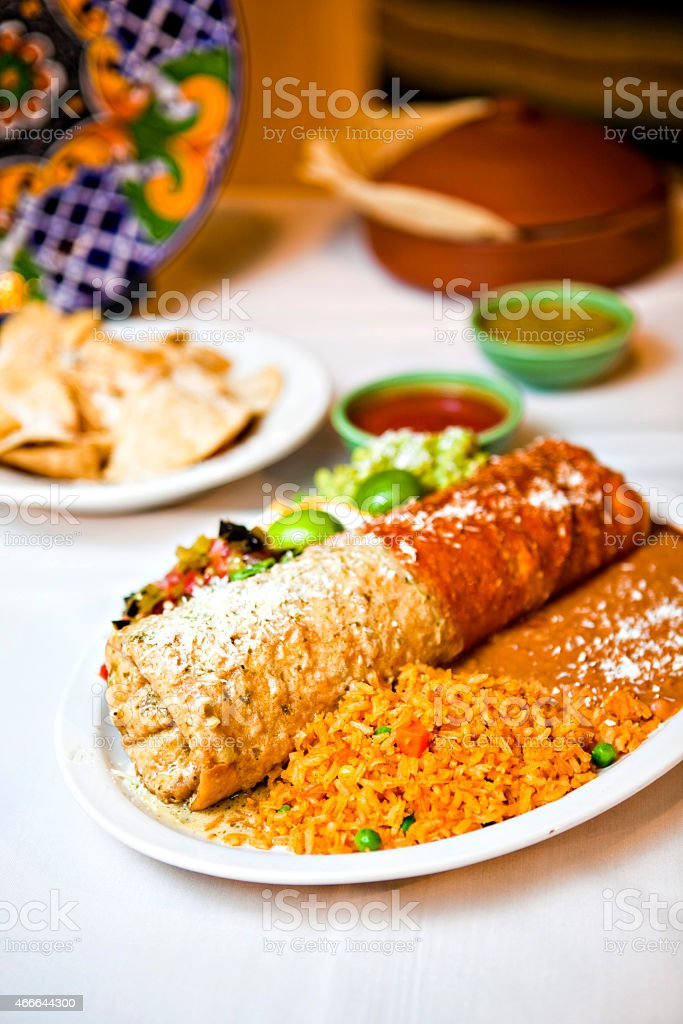 Chimichanga on plate with salsa in background. stock photo