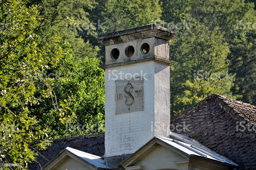 1890: Chimney and Forest in the backgorund stock photo