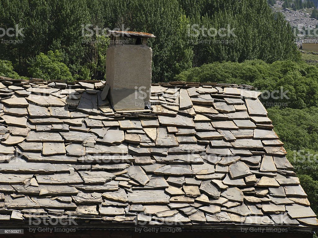 chimney  and old roof made with stones in the Alps royalty-free stock photo