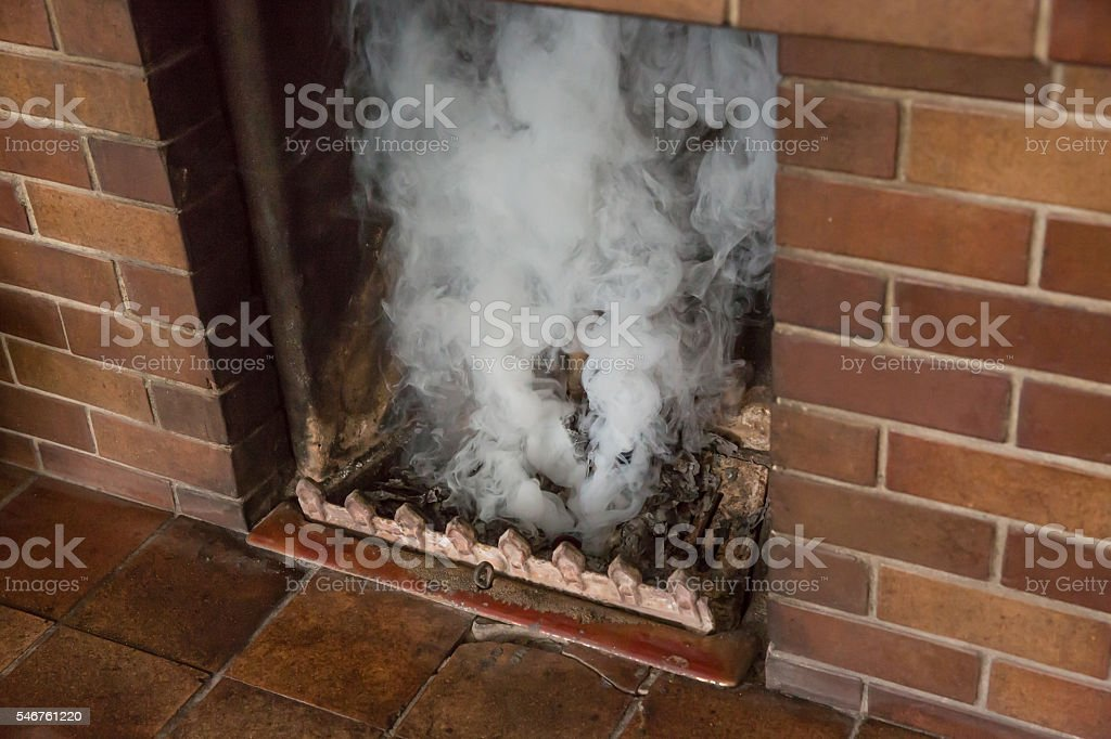 Chimney being tested with a smoke bomb after cleaning stock photo