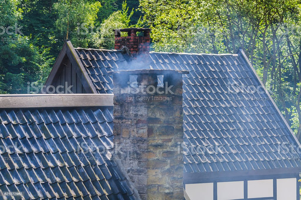 Chimney built with mortar from old quarrystones stock photo