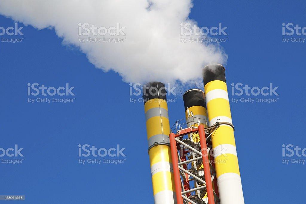 Chimney emitting smoke stock photo