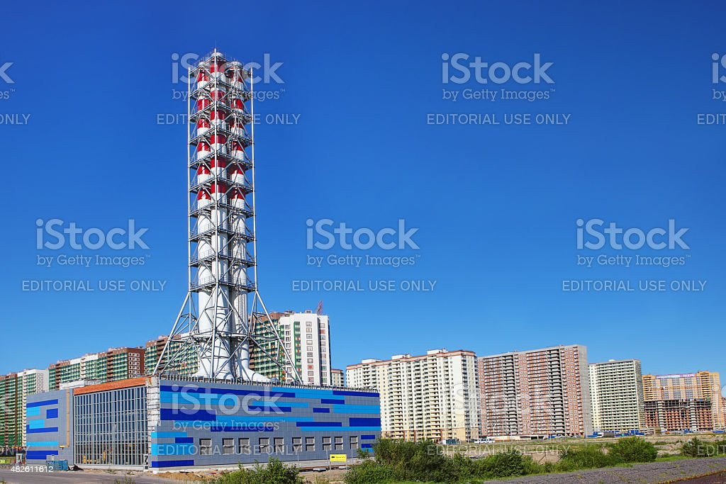 chimney modern industrial boiler, district heating plant stock photo
