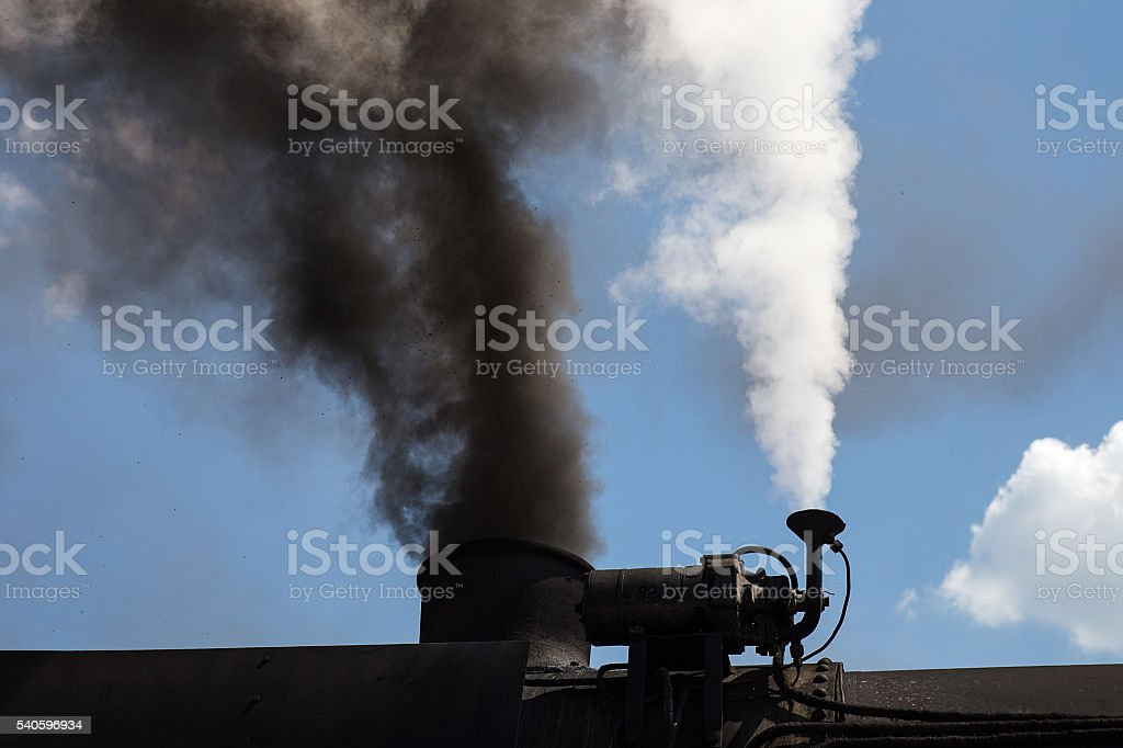 Chimney of Old Steam Locomotive with Smoke and vapour stock photo