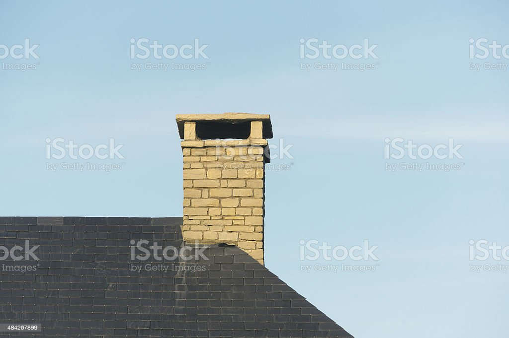 chimney on house roof stock photo