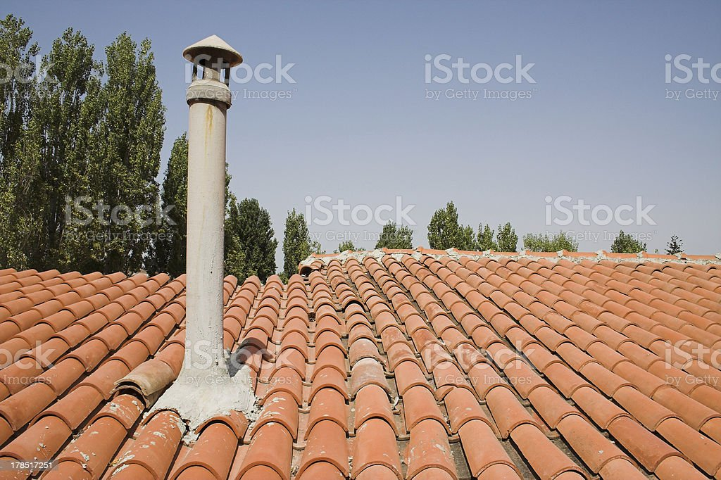 Chimney on terracotta roof stock photo