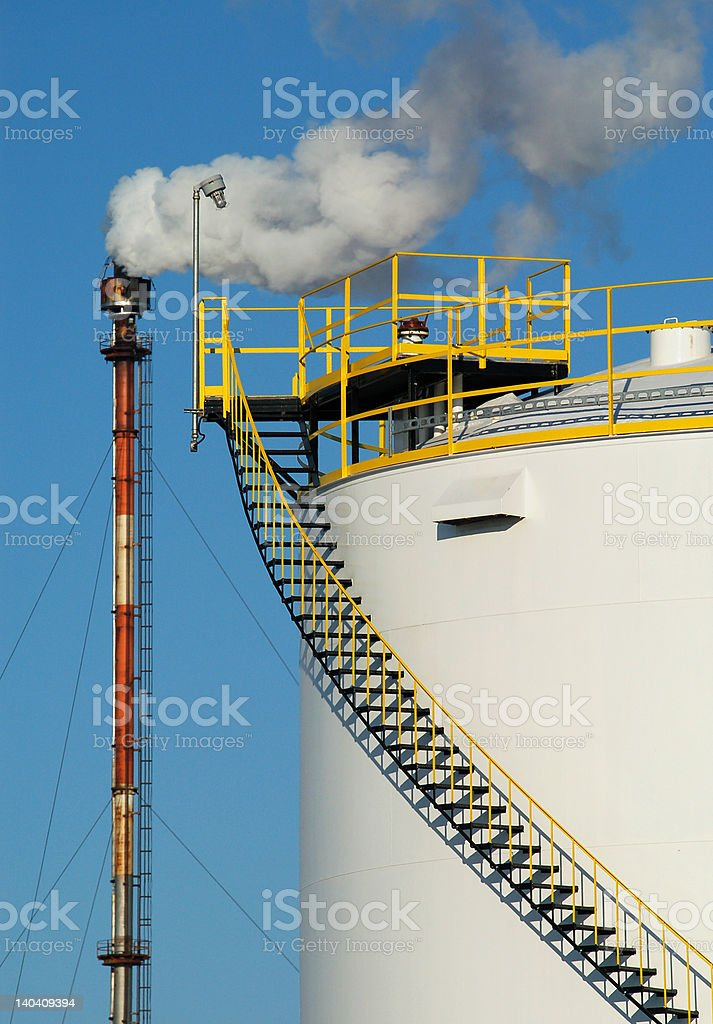 Chimney, smoke & oil tank royalty-free stock photo