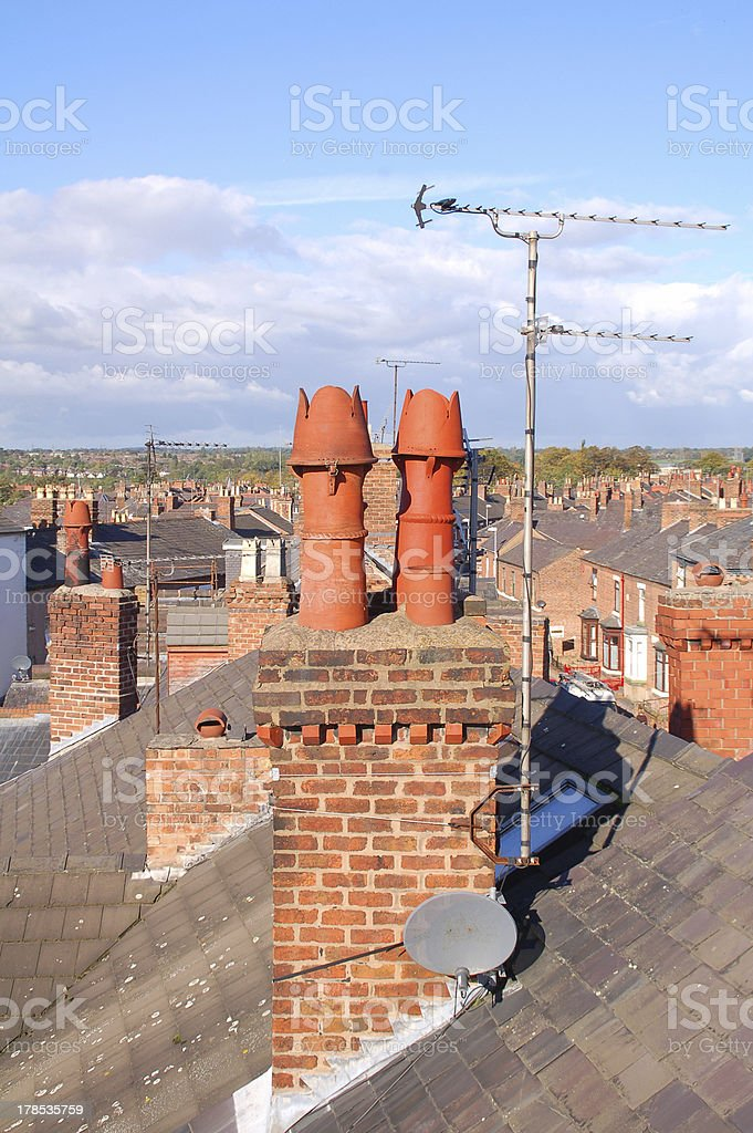 Chimney Stack Over The Rooftops royalty-free stock photo