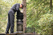 Chimney Sweep cleaning chimney