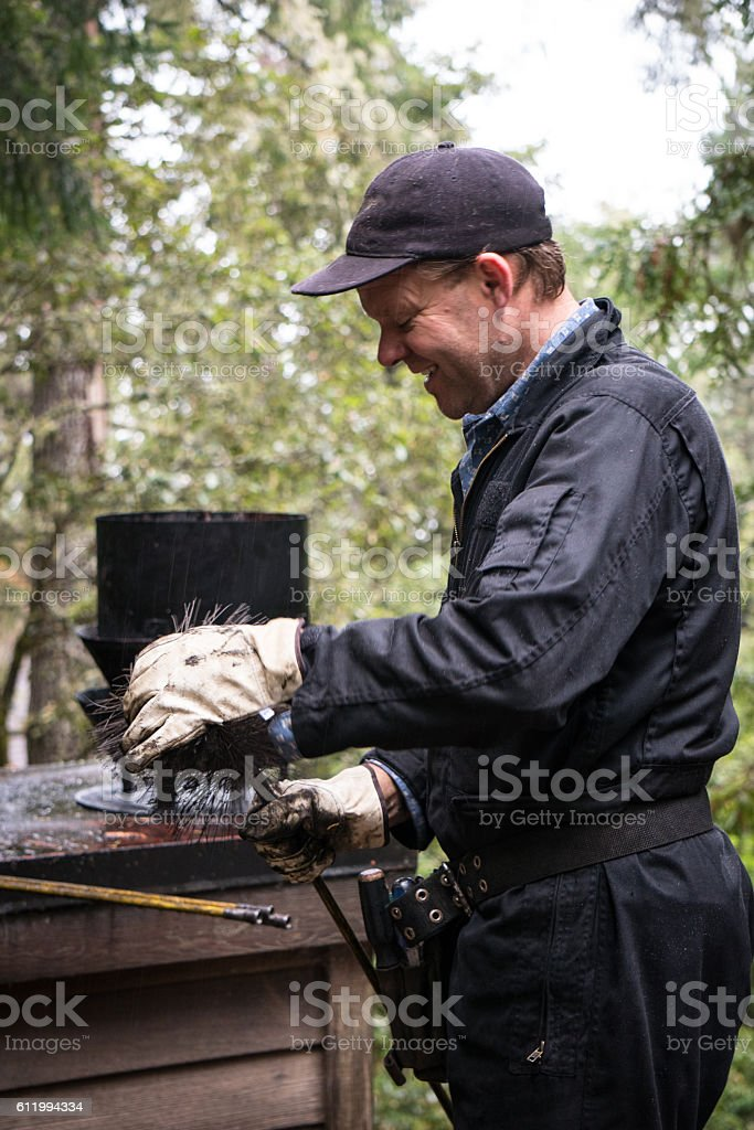 Chimney Sweep cleaning chimney stock photo