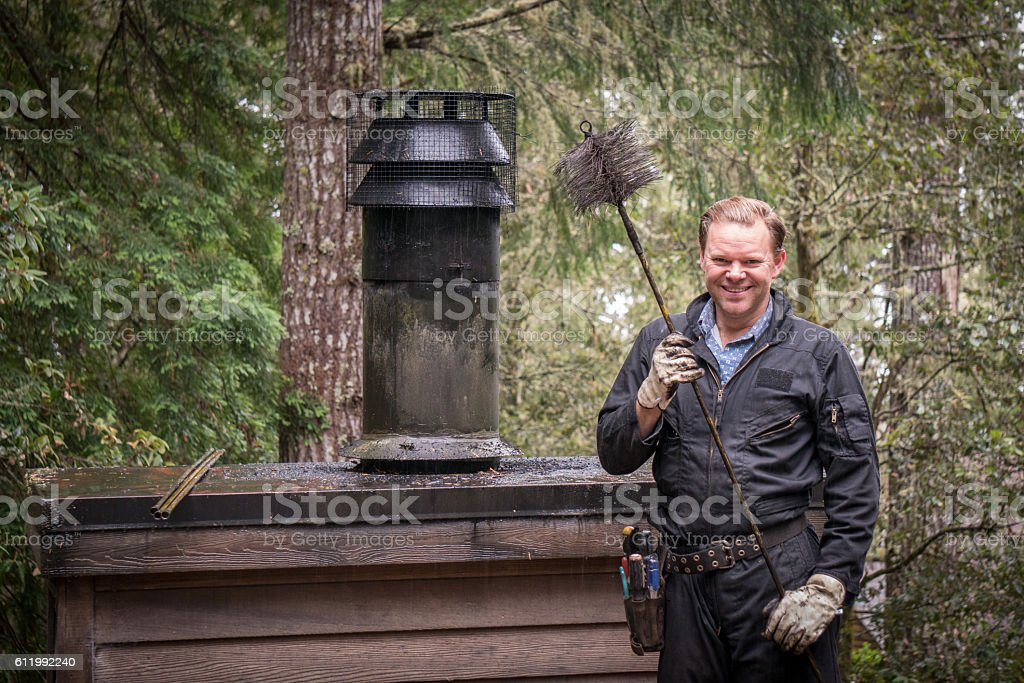Chimney Sweep cleaning stock photo