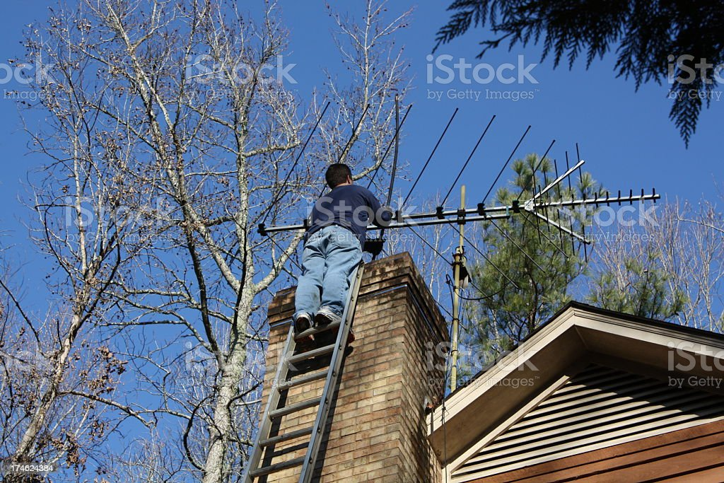 Chimney sweep working on a ladder stock photo