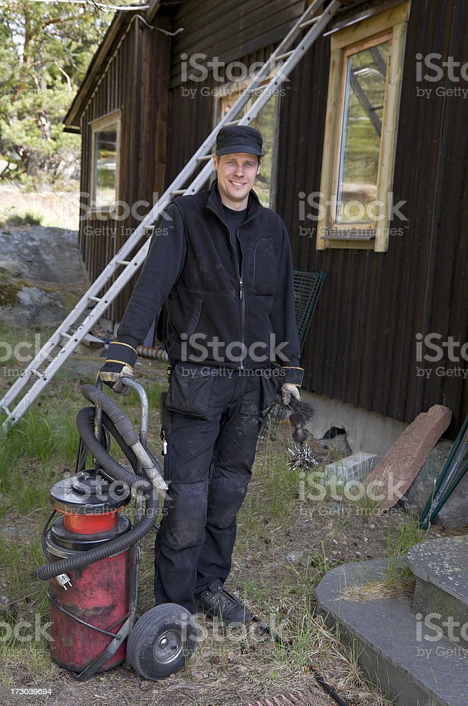 Chimney sweeper with his tools stock photo