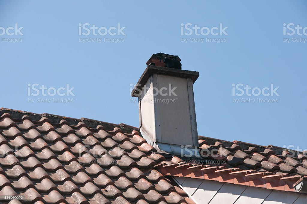 Chimney with asbestos lagging stock photo