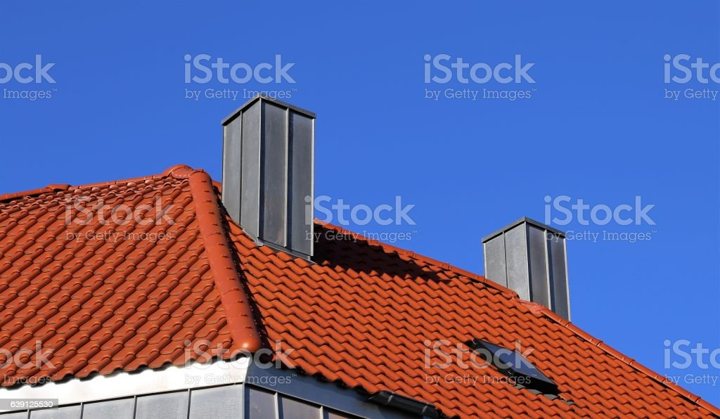 Chimney with stainless steel cladding stock photo