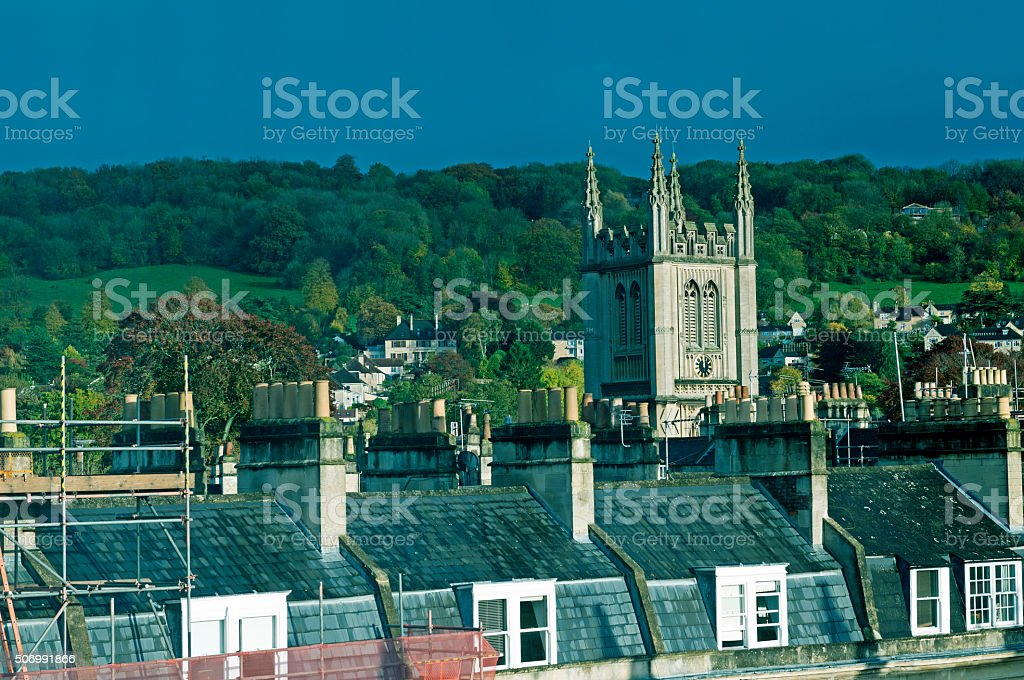 Chimneys and church bell tower in Bath England stock photo