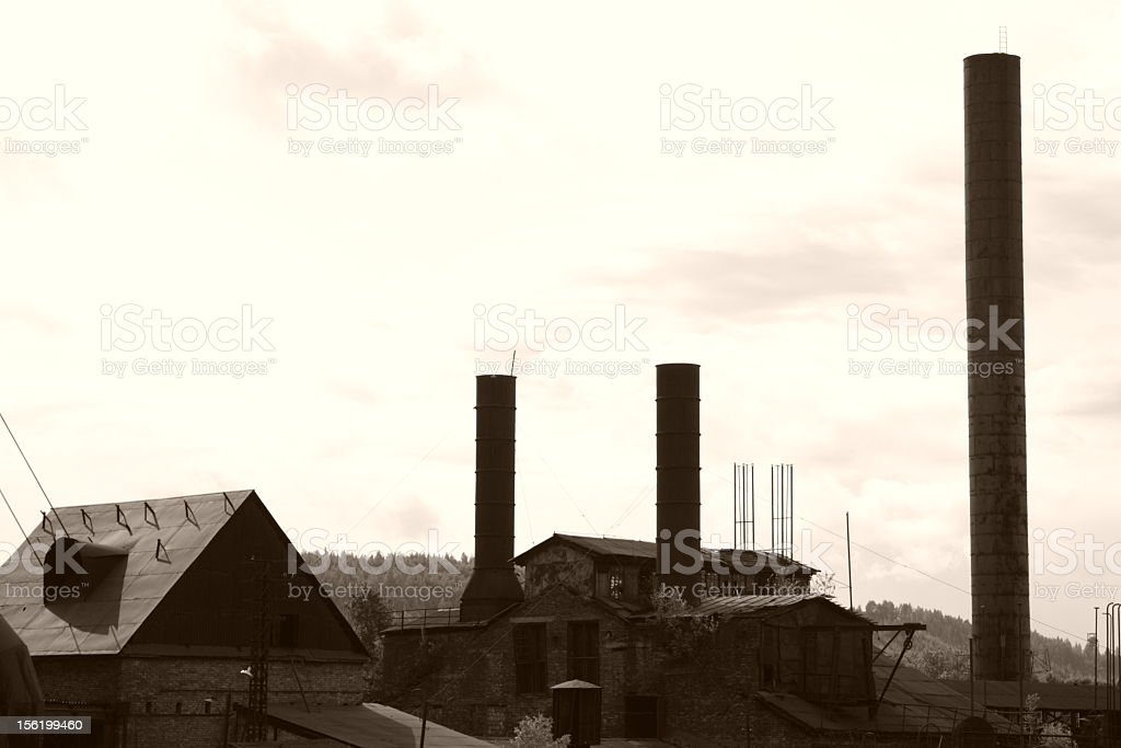 chimneys of old factory stock photo