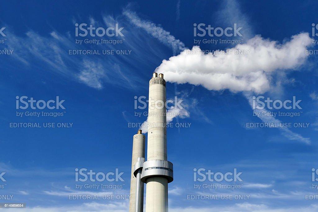 Amsterdam, The Netherlands - September 10, 2016: Chimneys spitting smoke stock photo