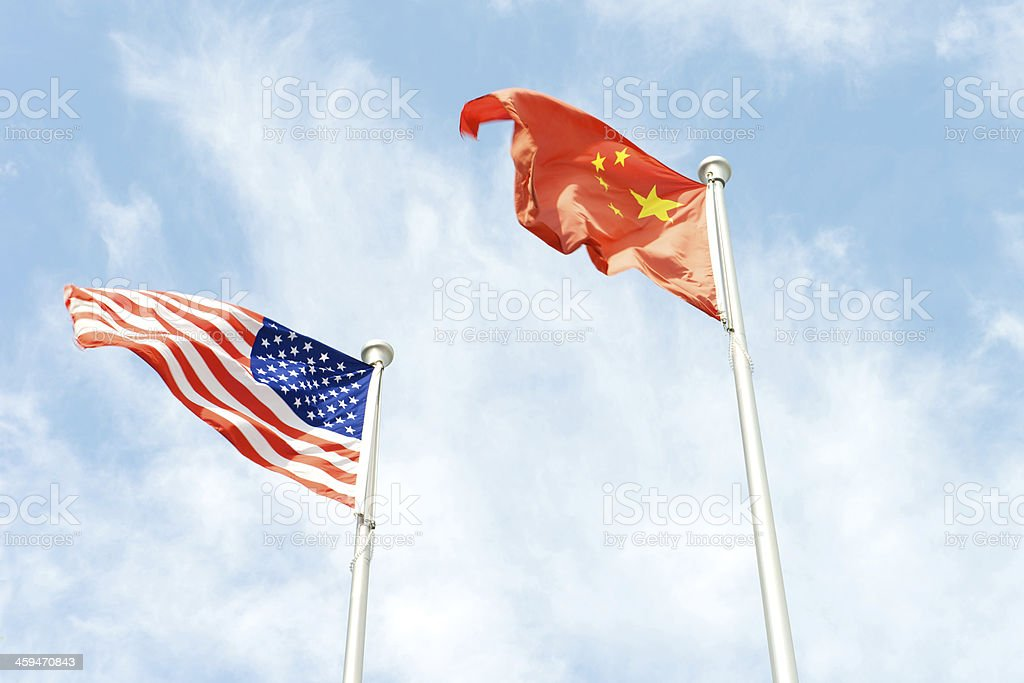 China and American flag flying together stock photo