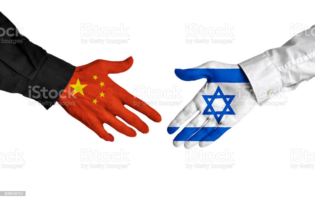 China and Israel leaders shaking hands on a deal agreement stock photo