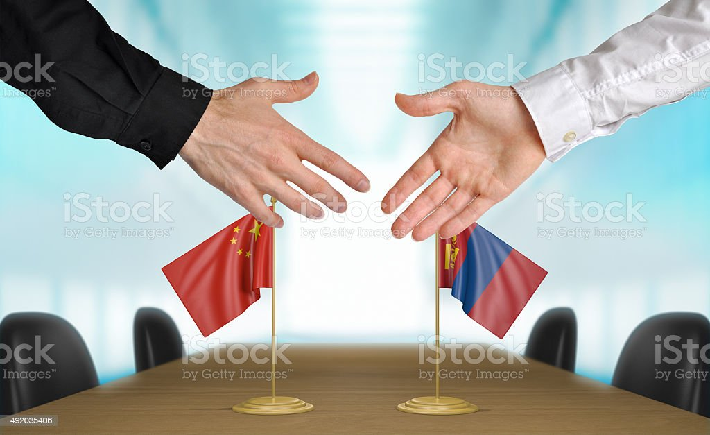 China and Mongolia diplomats agreeing on a deal stock photo