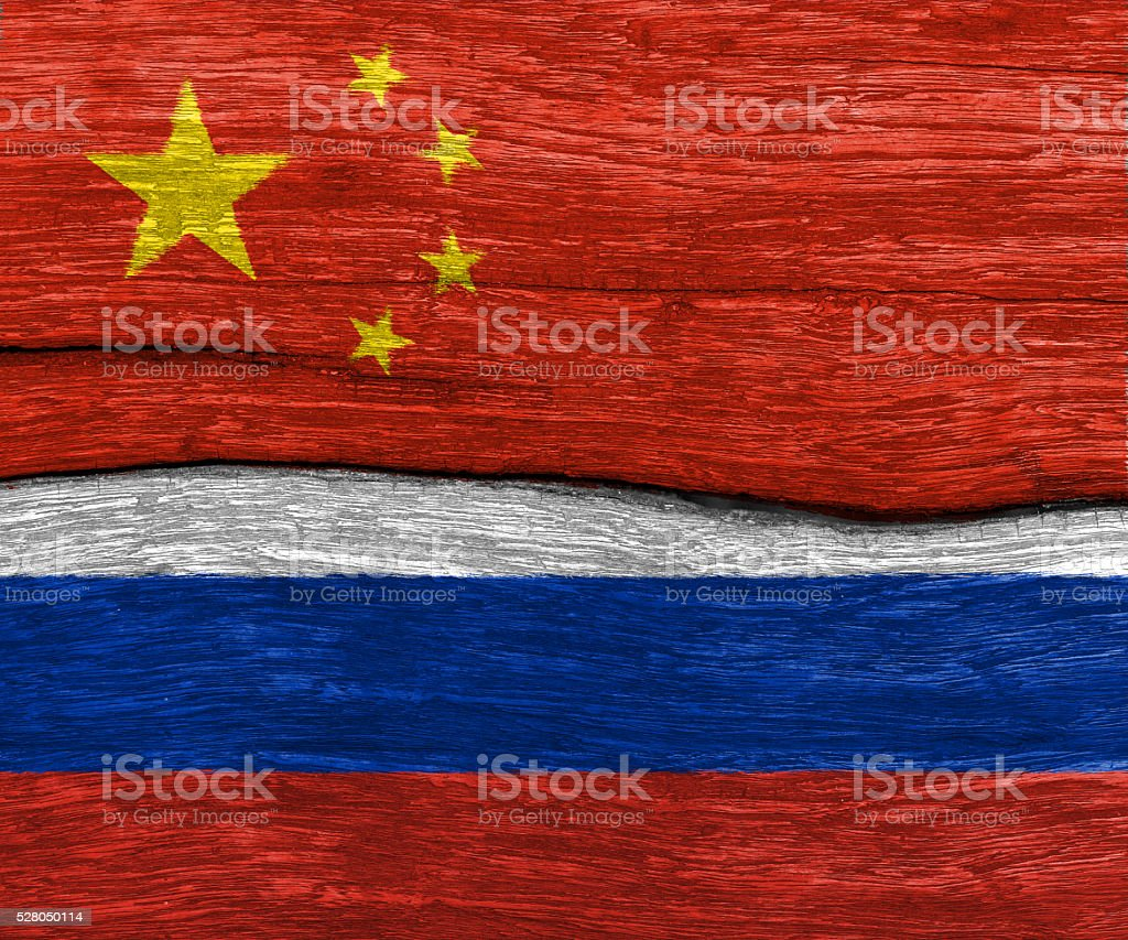 china and russia flag on wood stock photo