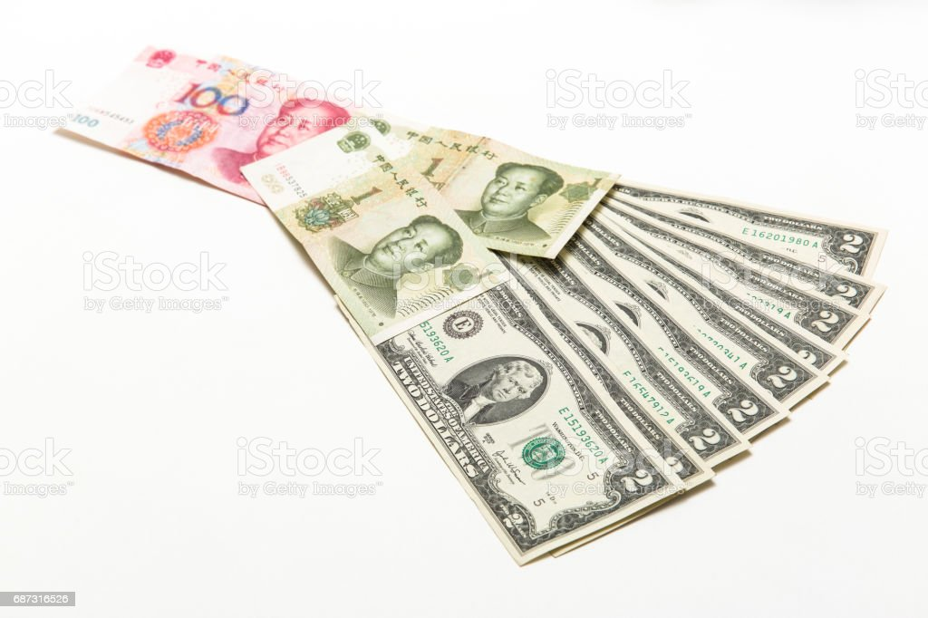 China bills and American two dollar bills on background stock photo