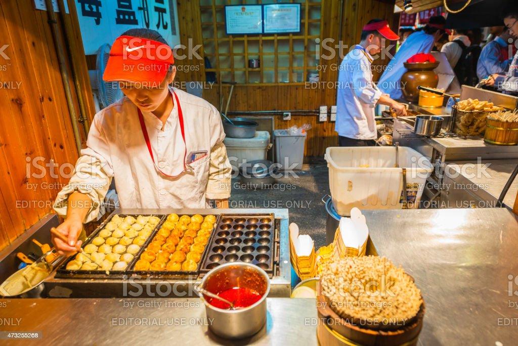 China chefs preparing cooking street food night market stalls Beijing stock photo
