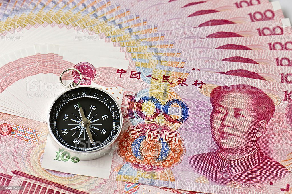 China currency and compass stock photo