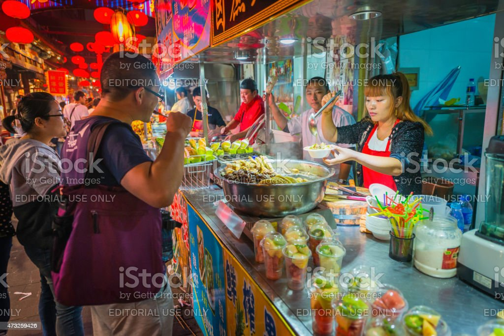 China customers and vendors at night market food stalls Beijing stock photo