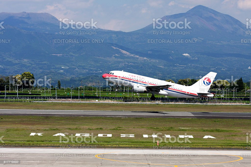 China Eastern Airlines Airbus A319 taking off at Kagoshima Airport stock photo