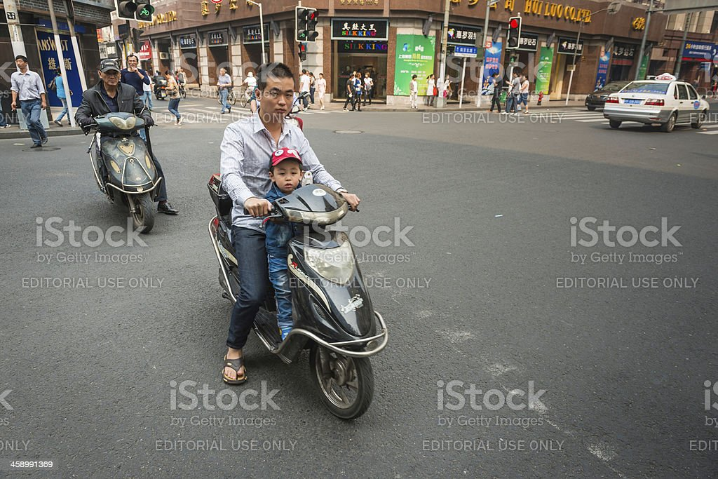 China father and son on scooter Shanghai royalty-free stock photo