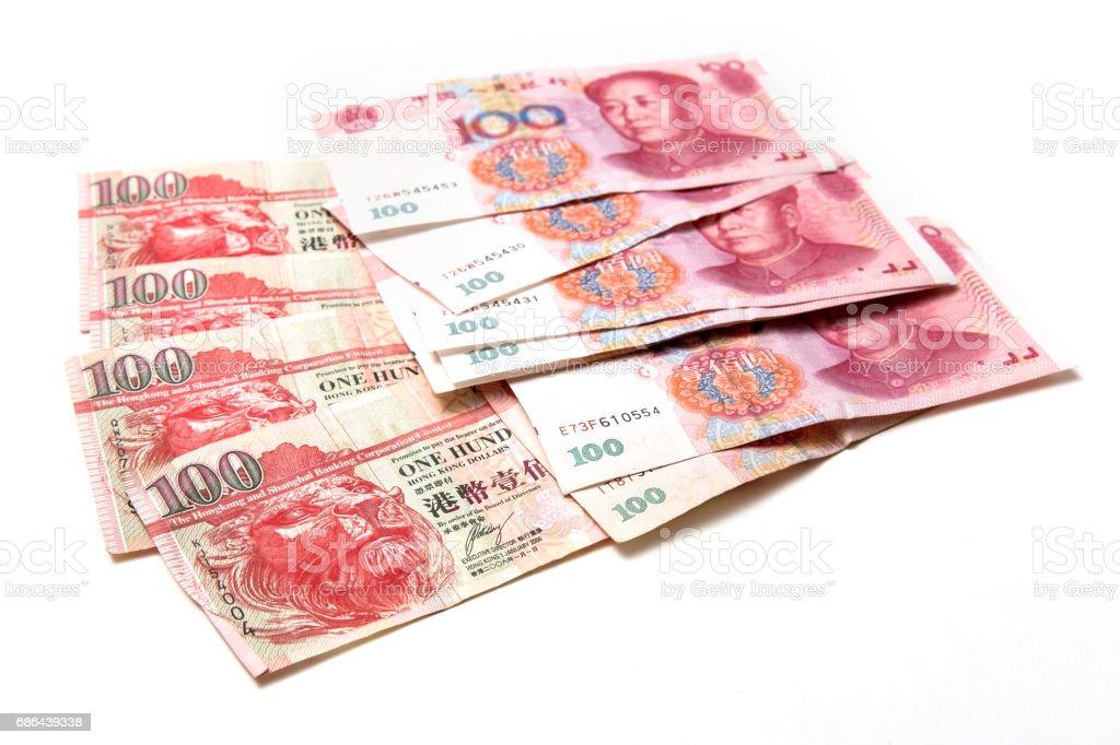 China hundread bills on top of hong kong hundread bills stock photo