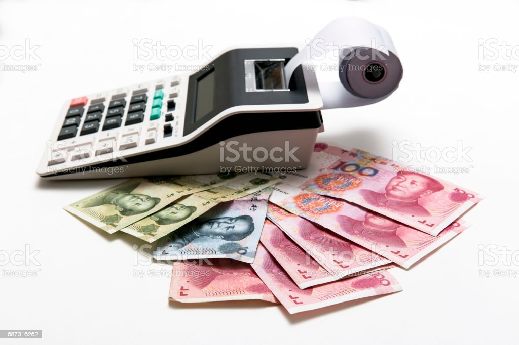 China money bills and calculator on background stock photo