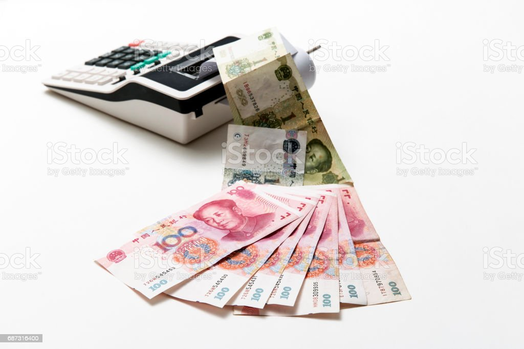 China money bills come out from calculator stock photo